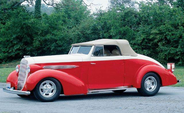 Left Side Red and White 1935 Oldsmobile 8 Car Picture
