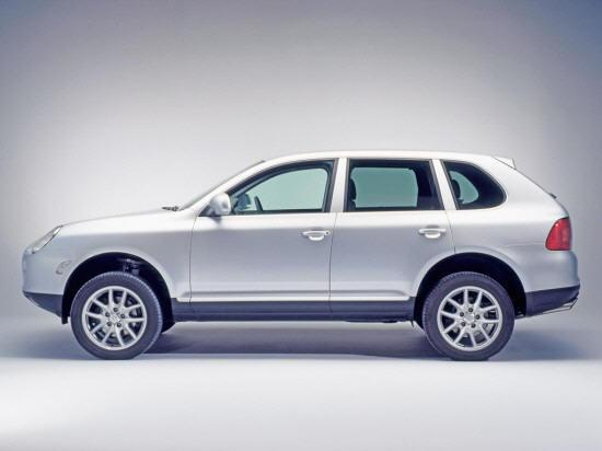 Presents a left side silver 2004 Porsche Cayenne SUV Picture